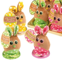Plush bunny on box filled with pralines, assorted