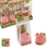 Small marzipan pig with clover leaf in cellophan bag